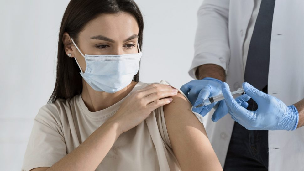 brunette-woman-being-vaccinated-by-doctor