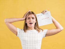 woman-putting-her-hands-her-head-period-calendar